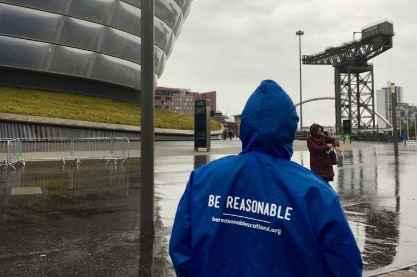 A Be Reasonable volunteer stands outside the SECC Glasgow.